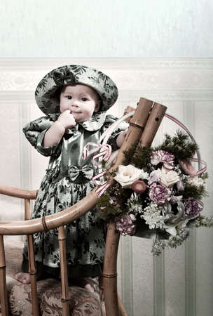 Victorian style portrait of cute little girl dressed in the formal wear. Copy space on the top Stock Photo - 756319