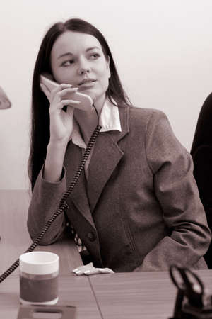 beautiful young manager making a phone call. Sepia Stock Photo - 782377