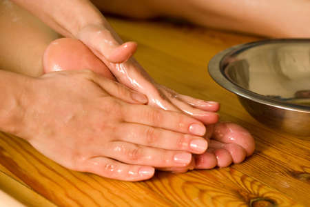 ayurvedic foot therapy massage procedure with oil photo