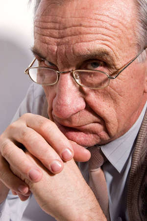 crinkles: Portrait of concentrated old man in glasses