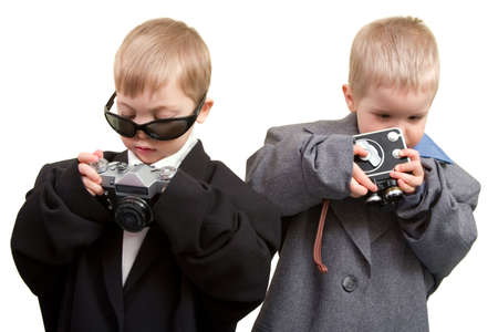 cine: Two boys in business wear with cine and photo cameras