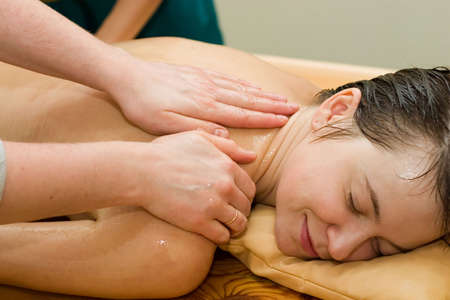 ayurvedic therapy: massage procedure with oil and pouch of rice and spices photo