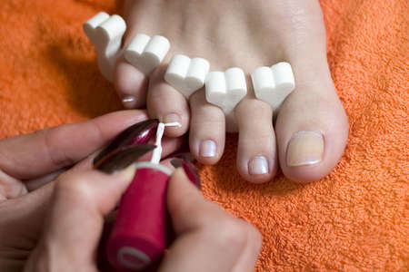 beautician making pedicure to the young woman. Close-up Stock Photo - 1124756