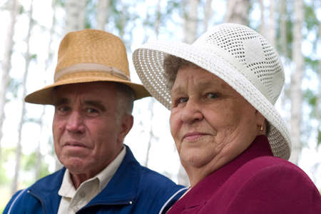 focal point: happy couple of seniors in the park. Soft-focused, focal point is on woman Stock Photo