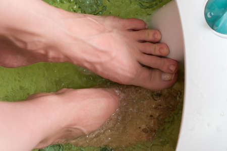 beautiful woman's foot relaxing in the water Stock Photo - 1543977