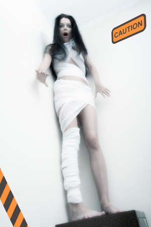 Young psycho girl in bandage have a stress. Special toned photo f/x Stock Photo - 1659701