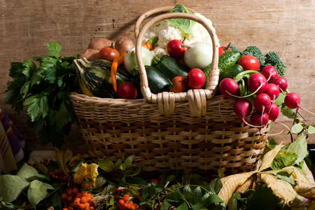 lots of fresh and ripe vegetables in the basket photo