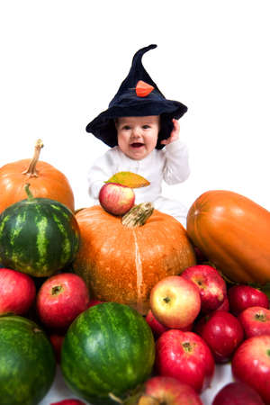 wizard hat: cute little boy in the wizard hat with lots of vegetables