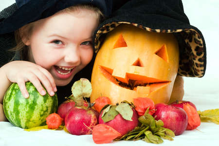 little laughing girl in the witch costume with halloween pumpkin Stock Photo - 1746666