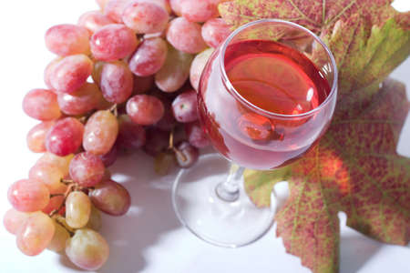 focal point: glass of rose wine and rose grapes. Low DOF, focal point is on wine Stock Photo
