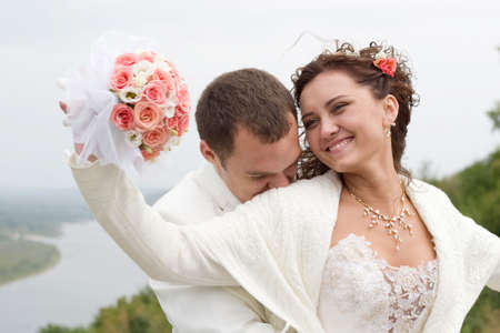 just married - young couple in wedding wear with bouquet of roses Stock Photo - 1904133