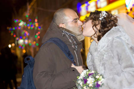 Just married young couple outdoors in winter photo