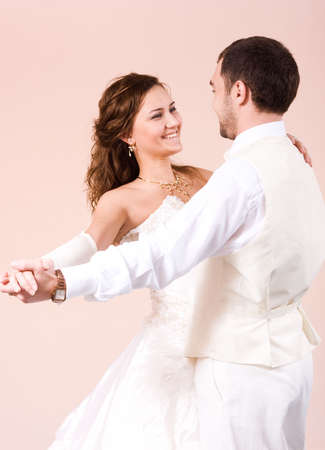 Beautiful couple - bride and groom - dancing photo