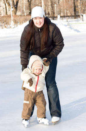 Mother and child on the ice rink Stock Photo - 2406755