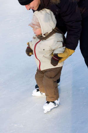two years: Ice-skating of two years boy. Iso 250, reporting shoot Stock Photo
