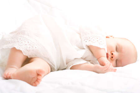 cute little baby sleeping on white blanket photo