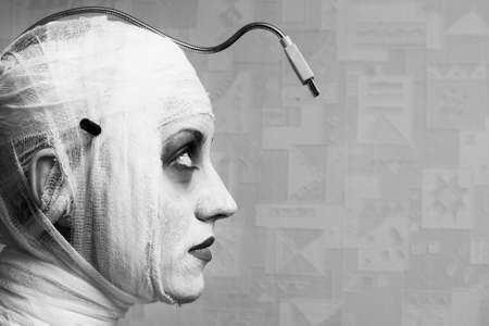 spooky female mime in heavy stage make-up photo