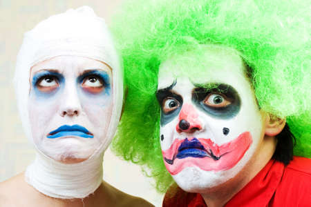 Two spooky clowns in heavy make-up photo