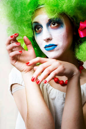 Sad female mime in heavy make-up photo