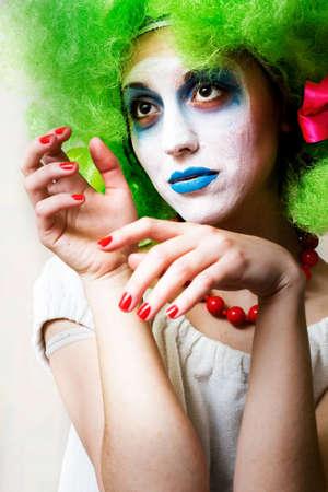 Sad female mime in heavy make-up photo