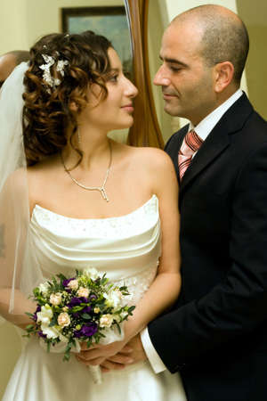 Just married young couple in wedding wear with bridal bouquet. Special toned photo f/x photo