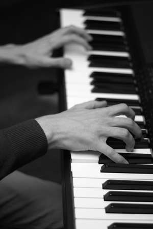 keyboard player: Hands of musician playing piano. Low DOF Stock Photo