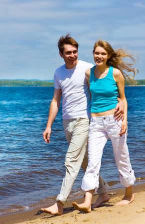 Happy loving man and woman at the beach photo