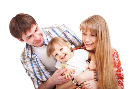 Happy family - mother, father and young cute daughter. Isolated on white. Stock Photo - 9369059