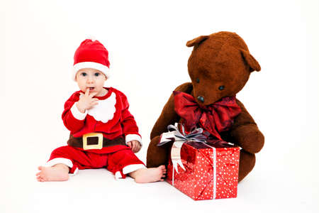 Portrait of cute little boy in Santa Claus costume. Isolated on white photo