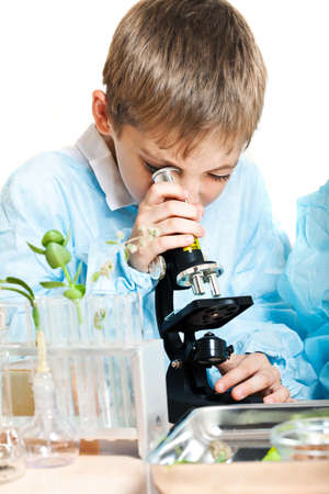 Little boy doing biochemistry research at the lab. Isolated on white Stock Photo - 17334434