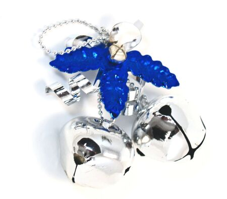 Silver and Blue Sleigh Bells Over White photo