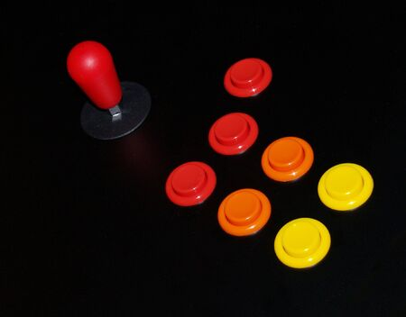 pushbuttons: Colorful Red Joystick and Arcade Buttons Stock Photo