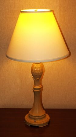 bedside: A Classic Tall Vertical Table Lamp Stock Photo