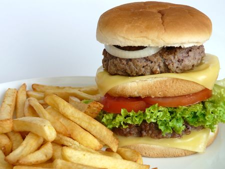 junkfood: A tasty looking Double Burger with some French Fries Stock Photo