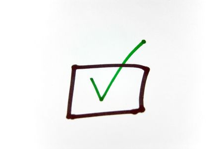 positiv: A close up view of a check mark in a square over white