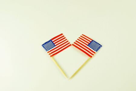 gimmick: A close-up view of two american flags over white