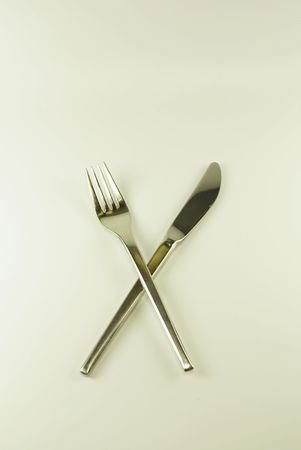 A close-up view of a fork and a knife photo