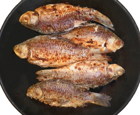 Carp fish is fried in a pan Stock Photo