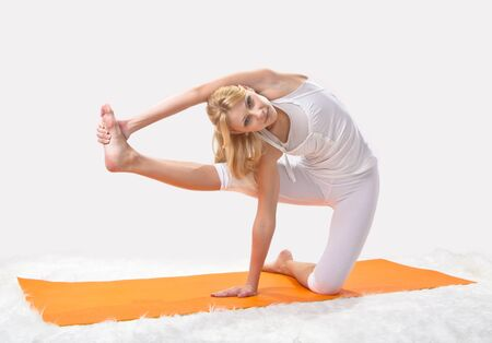 professionally: Young beautiful girl is professionally engaged in yoga Stock Photo