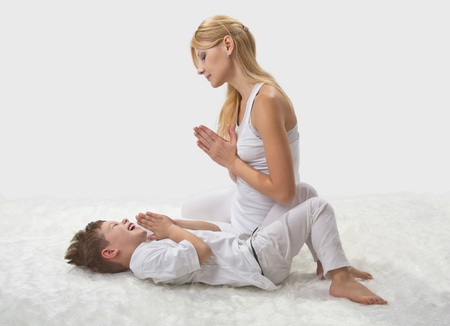 mom and son: Mother and son do yoga before bed  Stock Photo