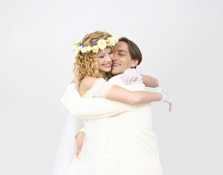 Young couple posing in a studio on the wedding day  Stock Photo - 12429980