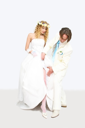 Young couple posing in a studio on the wedding day Stock Photo - 12429981