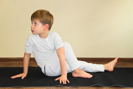 1 boy only: Baby yoga at home  Stock Photo
