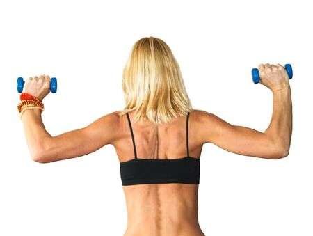 gym dress: Beautiful athletic muscular woman working with two dumbbells Stock Photo