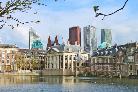Binnenhof Palace - Dutch Parliamen against the backdrop of modern buildings. Den Haag, Netherlands.