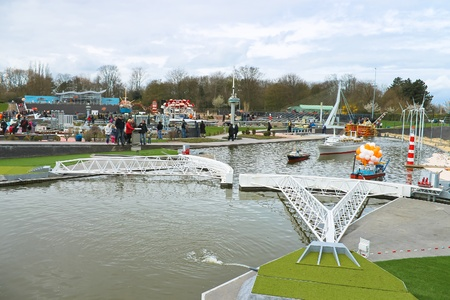 THE HAGUE, NETHERLANDS - APRIL 7: Visiting tourists Madurodam exposition updated April 7, 2012 in Den Haag. Adjustable Dam in the North Sea, The Netherlands Stock Photo - 14138613