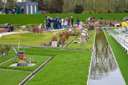 THE HAGUE, NETHERLANDS - APRIL 7: Visiting tourists Madurodam exposition updated April 7, 2012 in Den Haag, The Netherlands Stock Photo - 14138618