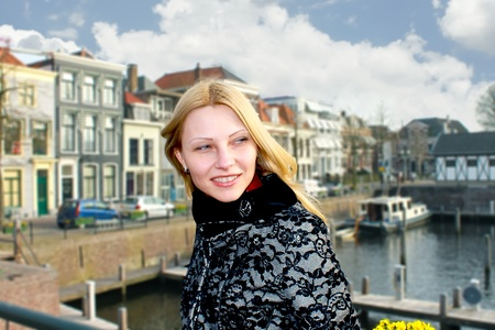 gorinchem: Girl on the waterfront in the Dutch town of Gorinchem. Netherlands Stock Photo