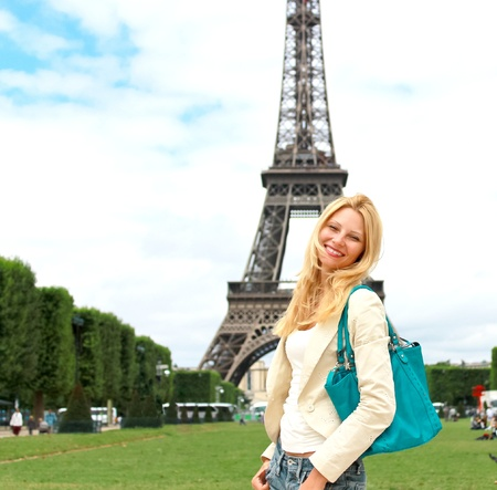 Vacation in Paris. Lucky girl near the Eiffel Tower