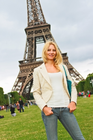 Vacation in Paris. Lucky girl near the Eiffel Tower  photo